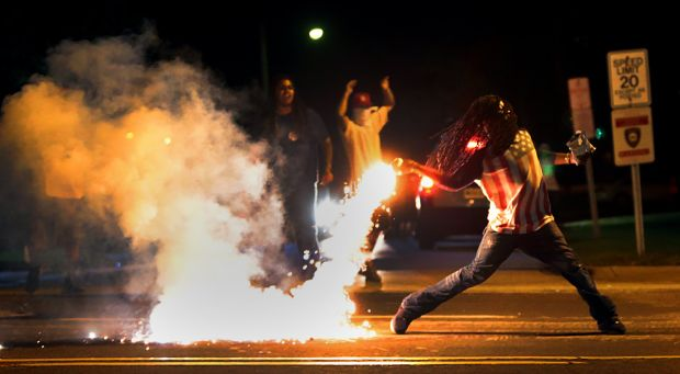 ferguson tear gas throwing